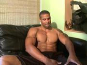 Black man with crazy washboard abs jerks it