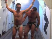 Hairy Muscle in Gay Bondage Scene