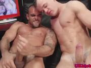 Muscle jocks tugging cock before blowjobs