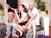 Redhead slut goes down on two stiff rods