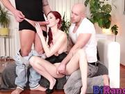 Redhead slut goes down on two stiff rods