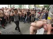 Bound nude guy flogged on the street