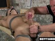 Taped and gagged stud gets tugged