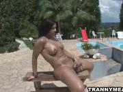 brunet tranny jerks off by the pool