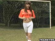 A sexy tranny on a soccer field masturbates