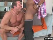muscular hunk gives a blowjob to a big cock