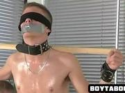 Restrained hunk gets tugged