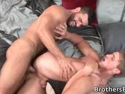 Two muscled gay studs fucking