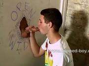 Aiden Jason sucks cock trough gloryhole