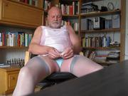 crossdresser masturbating cumming into condom
